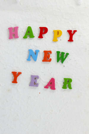 Colorful character made from resin  Happy New Year put word  photo