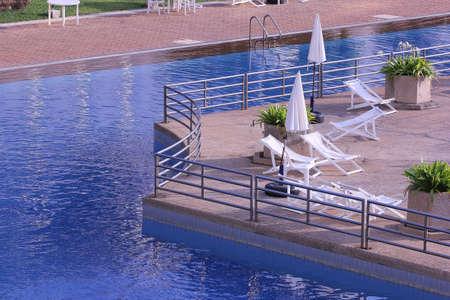 umbella: swimming pool with umbella