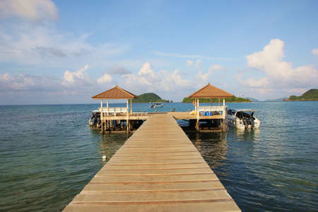 The bridge leading to  pavilions over the sea and  pier , at Koh Mak Island,Thailand photo