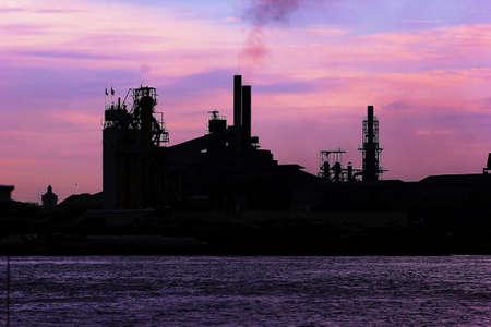 emission: Factory smoke emission river evening