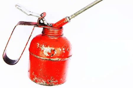 lubricator: A red engine oil container isolated on white background  Stock Photo