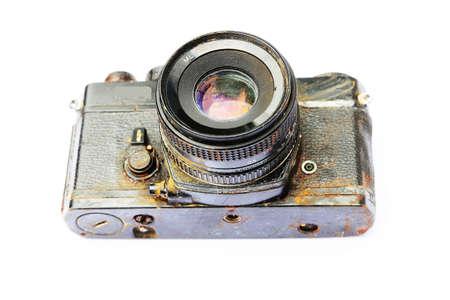 corrode: Old  SLR film camera  corrode   isolated on white background  Stock Photo