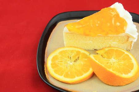 Orange jam cake on white background  photo