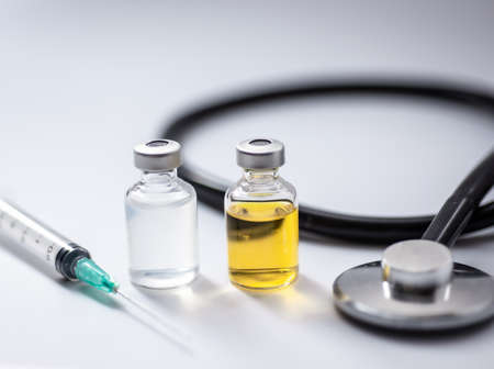A dollar bill and stethoscope with syringe is inserted into the bill. The concept is the fall of the economy. Inflation, covid-19 pandemic Standard-Bild