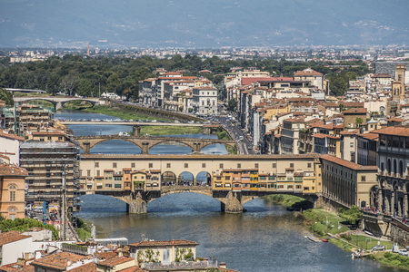 enthroned: Florence, Italy- August 12, 2016: Cityscape of the city of Florence with the Ponte Vecchio overlooking the Arno River in Florence, Italy