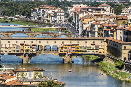 the firmament: Florence, Italy- August 12, 2016: Cityscape of the city of Florence with the Ponte Vecchio overlooking the Arno River in Florence, Italy