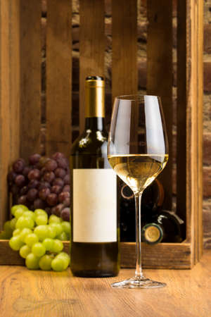 white wine: White wine with grapes Stock Photo