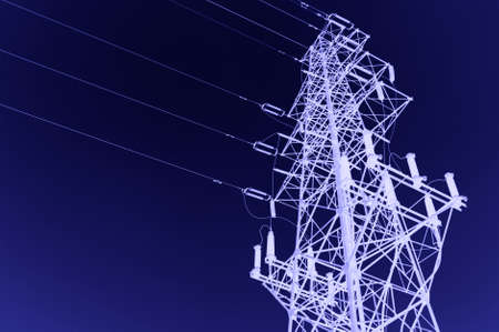 electric grid: high voltage post.High-voltage tower sky background.  Stock Photo