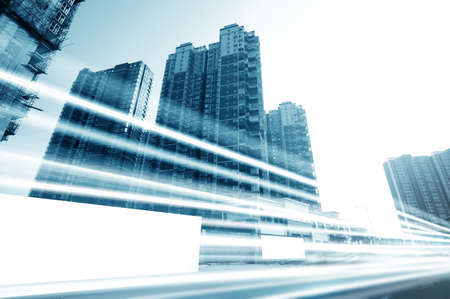 business building: the light trails on the modern building background in shanghai china