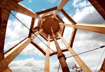 municipal utilities: concrete water tower against blue sky