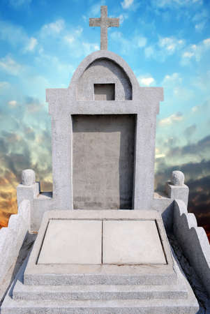 Tombstone in the sky background photo