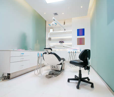 reclining chair: The white interior of a dentist office  Dentist office Editorial