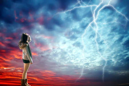 girl looked at the lightning in the sky Stock Photo - 16972127