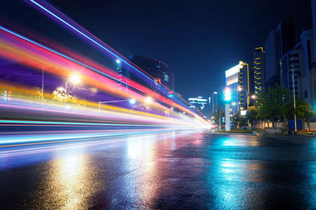 the light trails on the modern building background in shanghai china.  Stok Fotoğraf