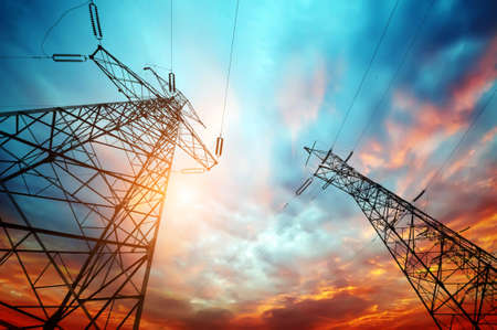 power grid: high voltage post at sunset Stock Photo