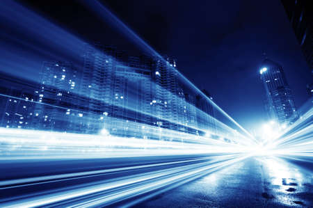 business communication: the light trails on the modern building background in shanghai china.  Stock Photo