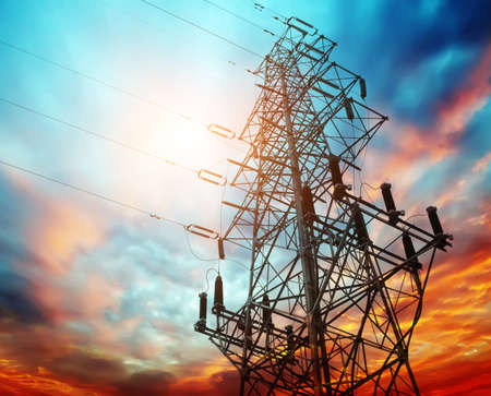 high voltage post at sunset Stock Photo