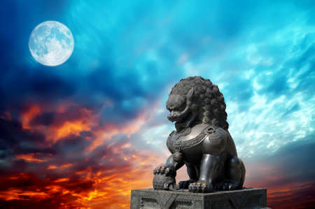 Chinese Imperial Lion Statue in the night sky photo