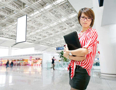 Young business woman on the background of a modern airport photo