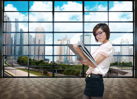business woman in modern glass interior photo