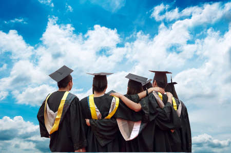 back of chinese graduates with blue sky  Stock Photo