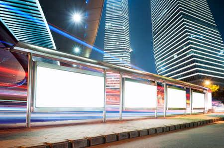 city lights: Blank billboard on bus stop at night  Stock Photo