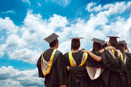 adult students: back of chinese graduates with blue sky
