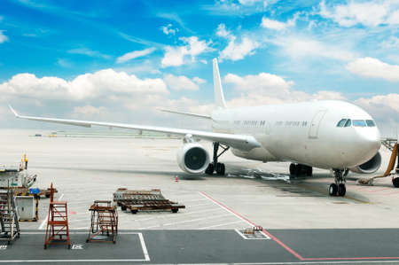 airport runway: The plane at the airport on loading   Stock Photo