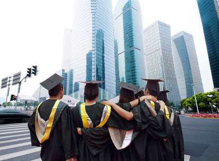 college graduation: Group of graduates will face the modern city