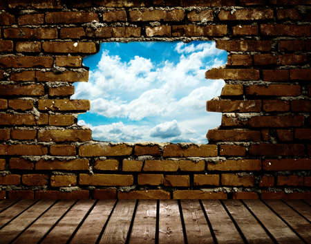 wall clouds: porous wall to see the blue sky Stock Photo
