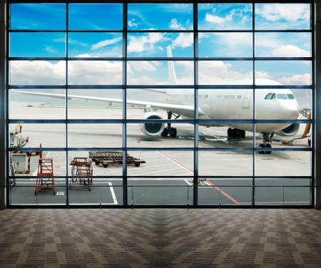 Parked aircraft on shanghai airport through the gate window  Stock Photo