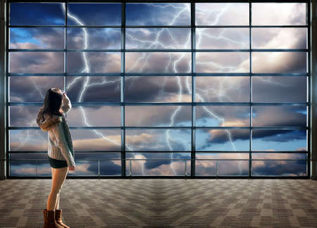 Through the large windows, Nature force background - lightnings in stormy Sky with dark clouds and rain photo