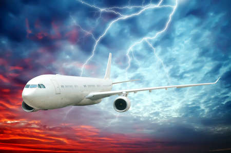 Aircraft flying in the night sky of lightning