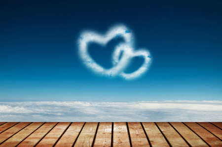valentine background: Two heart shaped clouds in the blue sky Stock Photo