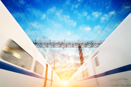 two modern high speed train with motion blur photo