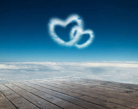 couple dating: Two heart shaped clouds in the blue sky Stock Photo