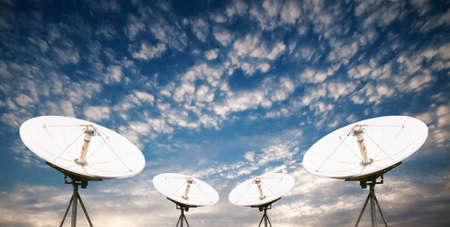 wireless technology: satellite dish antennas under sky Stock Photo
