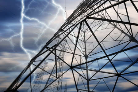Dramatic Image of Power Distribution Station with Lightning Striking Electricity Towers photo