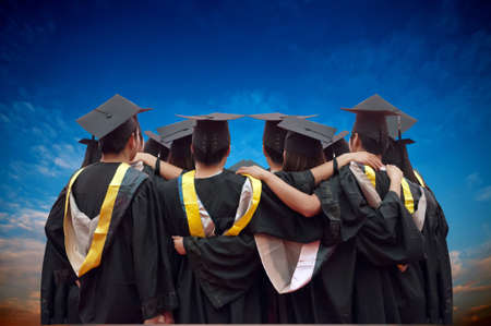 cap and gown: back of chinese graduates with blue sky