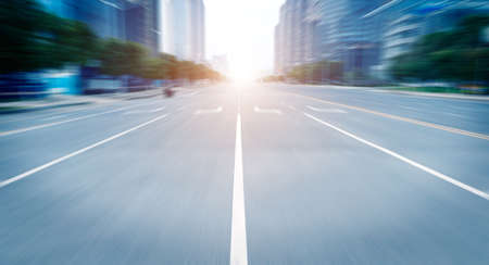 road in city with sunset Standard-Bild