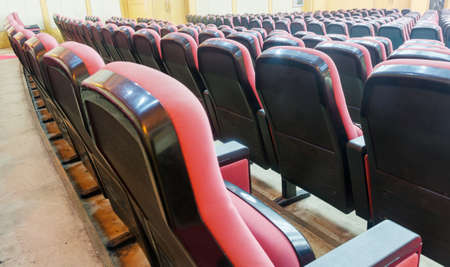 Empty hall for presentation with red armchairs photo