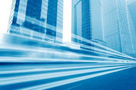 business background: the light trails on the modern building background in shanghai china.  Stock Photo