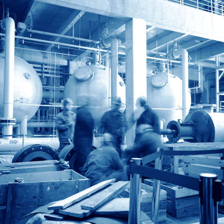 maintenance engineer checking technical data of heating system equipment in a boiler room photo