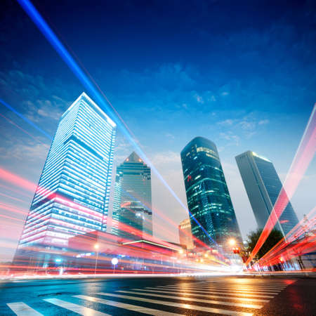 office background: the light trails on the modern building background in shanghai china.  Stock Photo