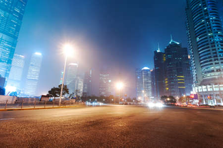 highway at night: the night view of the lujiazui financial centre in shanghai china   Stock Photo