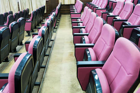 Empty hall for presentation with armchairs photo