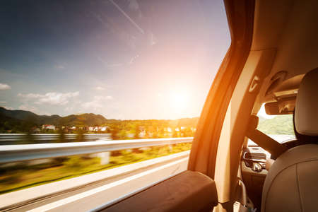car on the road wiht motion blur background Stock Photo