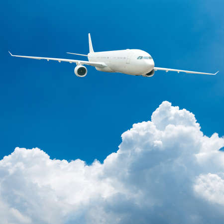 Large passenger plane flying in the blue sky photo
