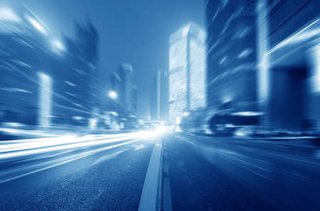 motion: the light trails on the modern building  Stock Photo