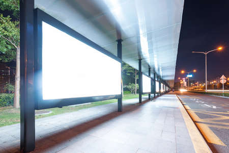 Blank billboard on bus stop at night  photo